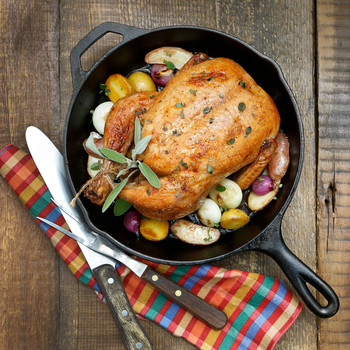 Roast Chicken with Potatoes and Onions in Cast Iron Pan