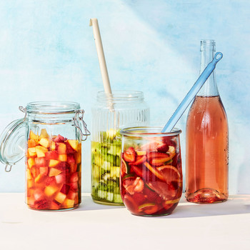 red pink white sangria jars drinks fruit