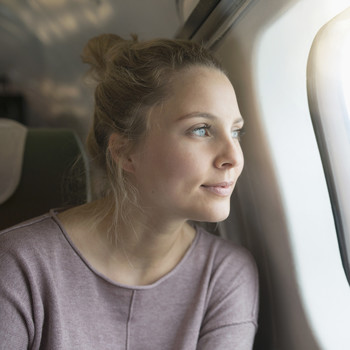 Woman Looking Out the Window on an Airplane