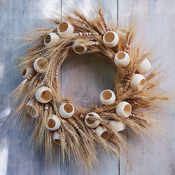 dried straw wreath with wooden beads