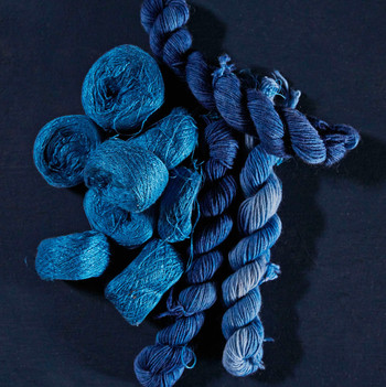 skeins of blue silk yarn