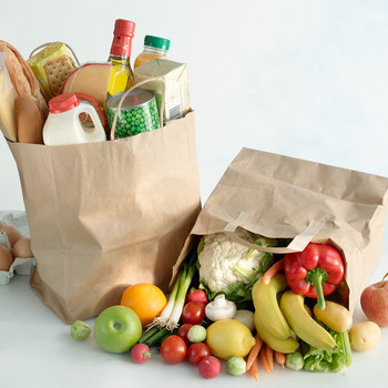 grocery bags with produce and other foods