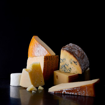 assortment of blocks of cheese