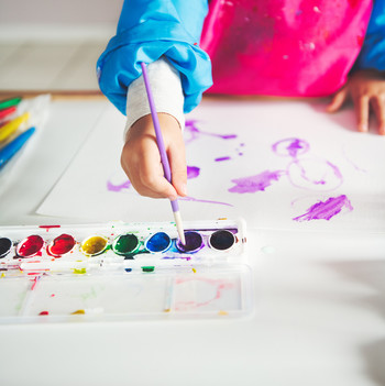 kid painting on paper