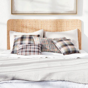 madras pillows on bed