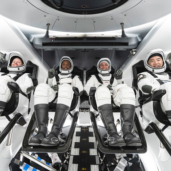 astronauts inside SpaceX's Crew Dragon spacecraft
