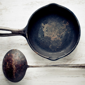 antique cast iron pan rusty
