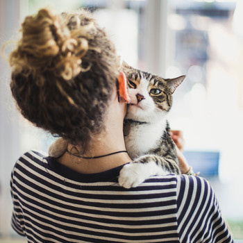 woman holding a cat