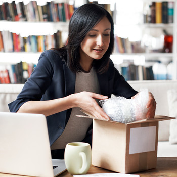 woman preparing box to be shipped