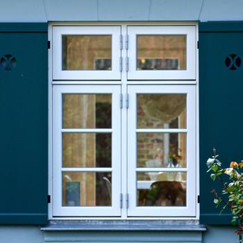 blue shutters on white window frames