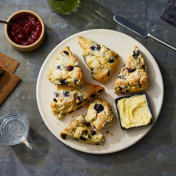 blueberry scones on plate with butter and jam