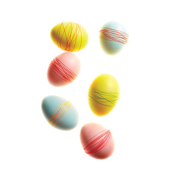 Thread-Wrapped Dyed Easter Eggs