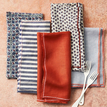 edged cloth napkins orange blue stripes folded