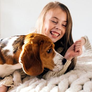 Girl with beagle dog
