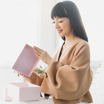 woman opening marie kondo box