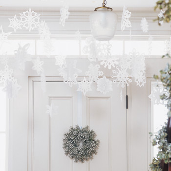 All of Our Prettiest Paper Snowflake Ideas (and the Templates You Need to Make Them at Home)