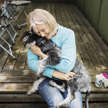 elderly woman dog embrace