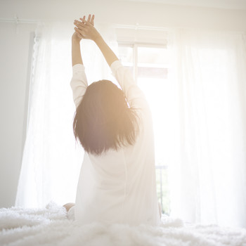 woman waking up to sun