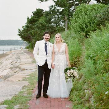 wedding couple portrait on walkway by water