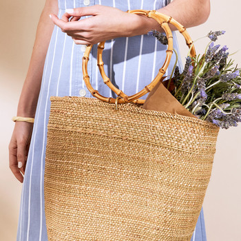 Person holding woven tote