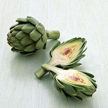 two artichokes one cut in half