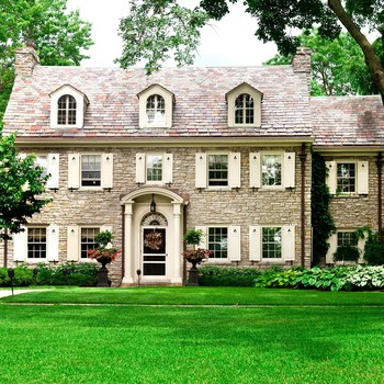 Colonial Home with Shrubs Outside