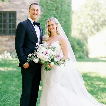 wedding couple posing in garden