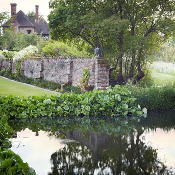 medieval moat surrounding sissinghurst in england