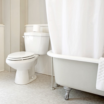 white bathroom interior with clawfoot tub