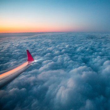 airplane amidst clouds