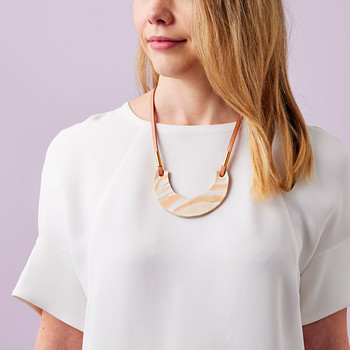woman wearing clay pendant necklace