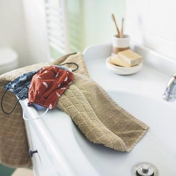 face masks handwashed in sink