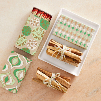 matches and palo santo bundles in holiday gift wrapped boxes