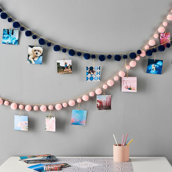 pink and blue photo garlands on light gray wall