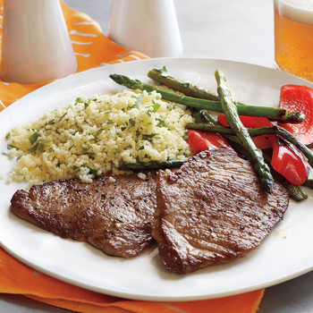 Pork Cutlets with Couscous and Sauteed Peppers and Asparagus