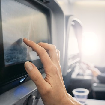woman watching movie on plane