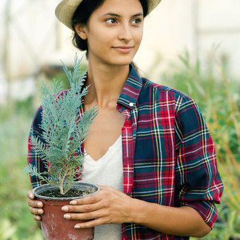 Woman Holding Plant at Garden Center