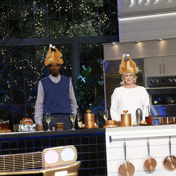 Martha and Snoop wearing turkey hats for the Thanksgiving episode of their show