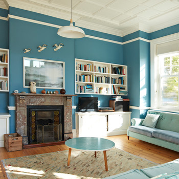 blue painted walls living room with fire place