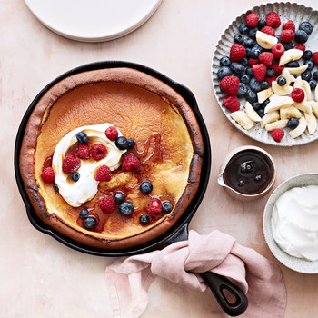 classic dutch baby topped with berries and cream