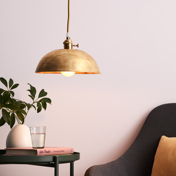 hanging brass lamp in pastel pink room
