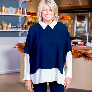 martha stewart posed on set with kitchen in background