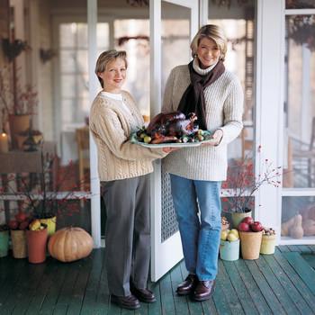 martha and friend holding turkey