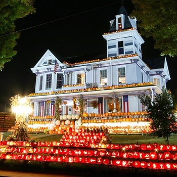 Victorian home decorated with pumpkins