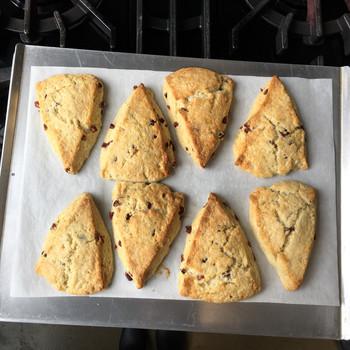 scones on baking sheet atop stove