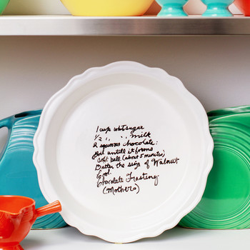 handwritten recipe on pie plate displayed