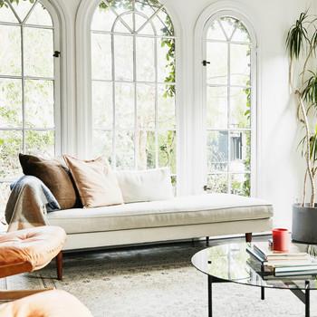 white spacious sun room with peach-colored chair