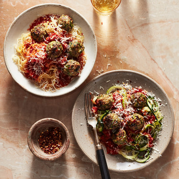 bowls of spaghetti squash and zucchini noodles with zucchini meatballs