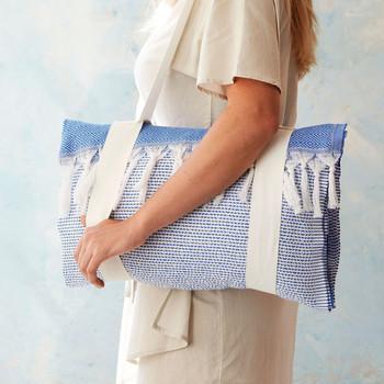woman holding beach towel tote bag