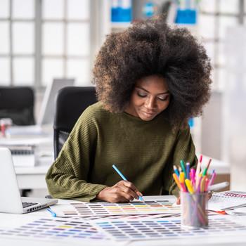 designer working in creative space on laptop